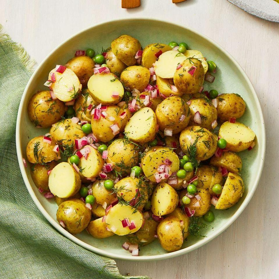"""<p>Ditch the heavy dressing and opt for a zippy red onion vinaigrette for this side dish, loaded with green peas and dill.</p><p><em><a href=""""https://www.goodhousekeeping.com/food-recipes/a35480400/potato-salad-with-vinaigrette-recipe/"""" rel=""""nofollow noopener"""" target=""""_blank"""" data-ylk=""""slk:Get the recipe for Potato Salad With Vinaigrette »"""" class=""""link rapid-noclick-resp"""">Get the recipe for Potato Salad With Vinaigrette »</a></em></p><p><strong>RELATED: </strong><a href=""""https://www.goodhousekeeping.com/food-recipes/healthy/g721/healthy-side-dishes/"""" rel=""""nofollow noopener"""" target=""""_blank"""" data-ylk=""""slk:35+ Healthy Sides Dishes That Go With Any and Every Protein"""" class=""""link rapid-noclick-resp"""">35+ Healthy Sides Dishes That Go With Any and Every Protein</a></p>"""