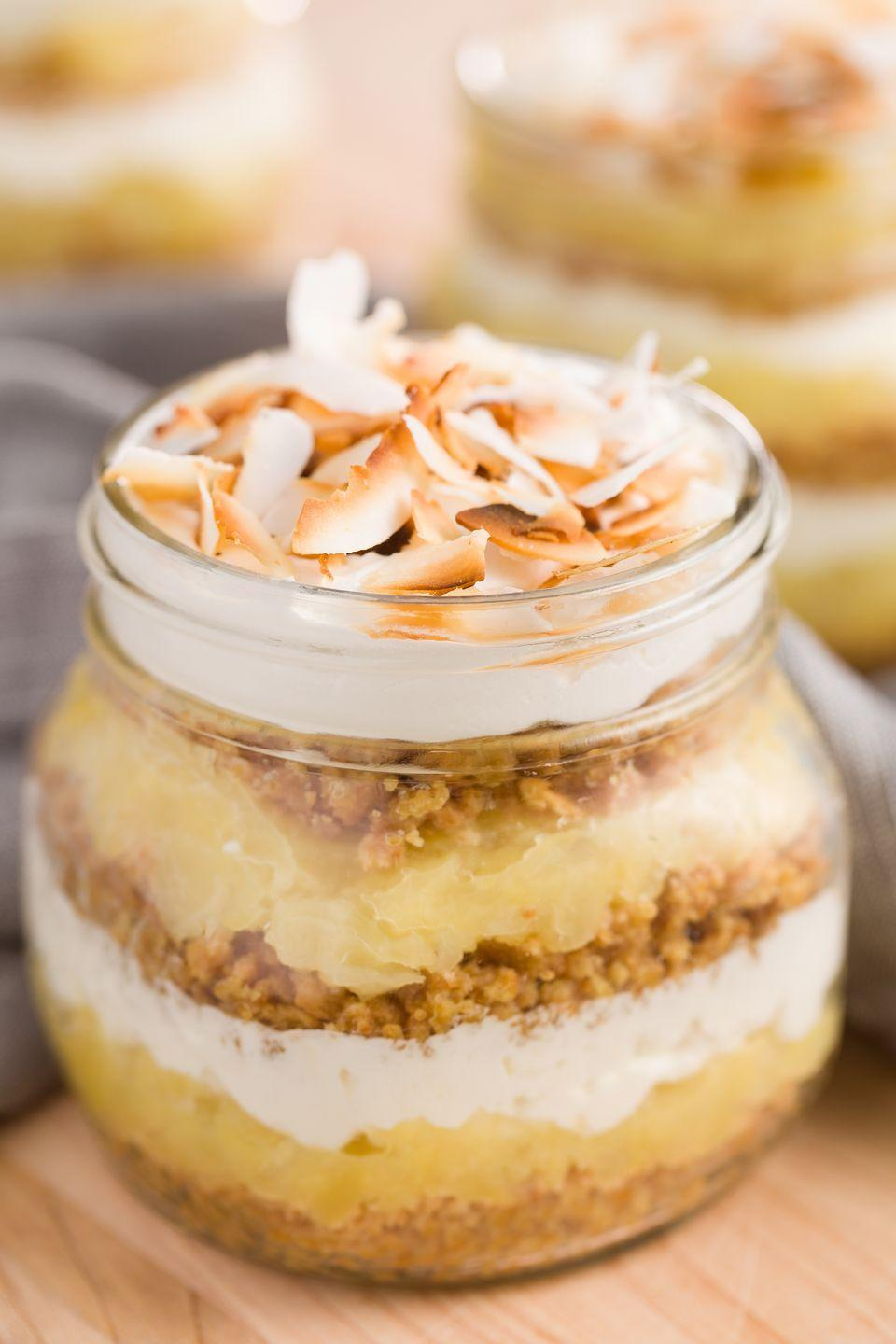 """<p>Cool down—while transporting to the tropics—with layers of buttery graham cracker crust, pineapple, and whipped cream cheese. </p><p>Get the recipe from <a href=""""https://www.delish.com/cooking/recipe-ideas/recipes/a43552/pina-colada-pie-in-a-jar-recipe/"""" rel=""""nofollow noopener"""" target=""""_blank"""" data-ylk=""""slk:Delish"""" class=""""link rapid-noclick-resp"""">Delish</a>.</p>"""