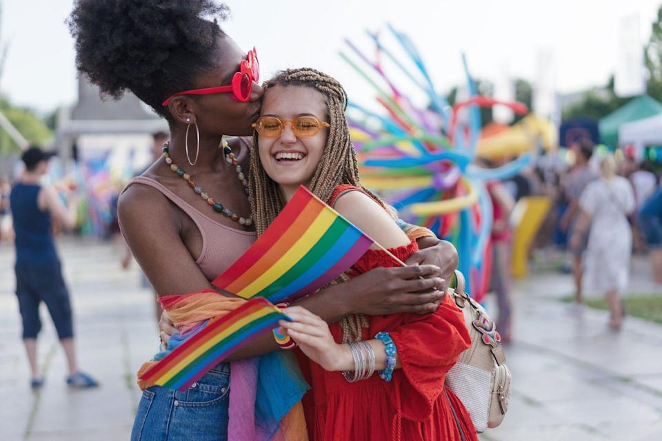 Girls kissing during Pride month event