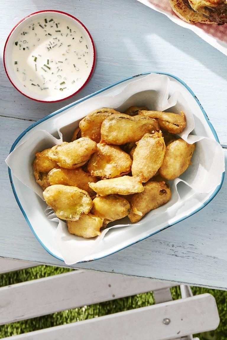 """<p>Warning: These bites will fly off the platter. Prepare to make a double—maybe even a triple—batch.</p><p><strong><a href=""""https://www.countryliving.com/food-drinks/a28069895/fried-pickles-with-buttermilk-ranch-recipe/"""" rel=""""nofollow noopener"""" target=""""_blank"""" data-ylk=""""slk:Get the recipe"""" class=""""link rapid-noclick-resp"""">Get the recipe</a>.</strong> </p>"""