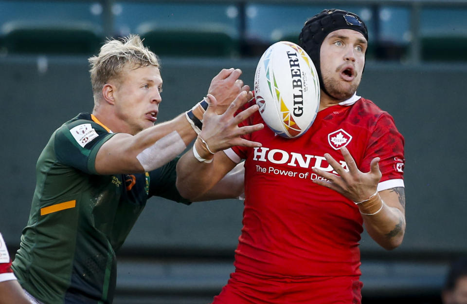 Canada's Jake Thiel, right, battles for the ball with South Africa's JC Pretorius during Canada Sevens rugby action in Edmonton, Alberta, Saturday, Sept. 25, 2021. (Jeff McIntosh/The Canadian Press via AP)