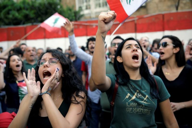 FILE PHOTO: Protesters chant slogans as as they demonstrate outside Lebanon's central bank during ongoing anti-government protests in Beirut