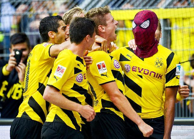 Dortmund's Pierre-Emerick Aubameyang celebrates after scoring his side's second goal  during the German soccer Super Cup match between Borussia Dortmund and Bayern Munich in Dortmund, Germany, Wednesday, Aug. 13, 2014