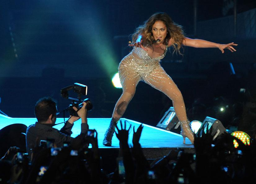 "<p class=""MsoNormal""><span>Although heavily produced, it was clear that JLo was having a good time as she strutted and jumped up and down on stage, defying gravity and balance in stiletto heals that must have added at least four inches to her height. Photo: Peter Harrison/Yahoo! Maktoob</span></p>"