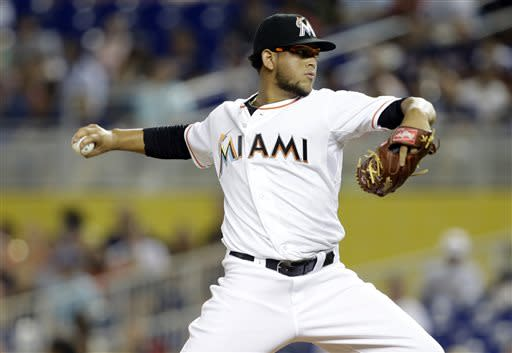 Miami Marlins starting pitcher Henderson Alvarez throws in the first inningduring a baseball game against the Atlanta Braves, Tuesday, July 9, 2013 in Miami. (AP Photo/Lynne Sladky)