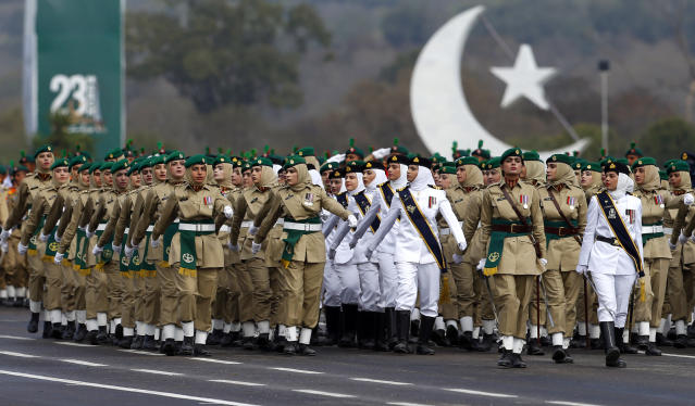 Female soldiers of Pakistan Army march during a military parade to mark Pakistan National Day, in Islamabad, Pakistan, Saturday, March 23, 2019. Pakistanis are celebrating their National Day with a military parade that's showcasing short- and long-range missiles, tanks, jets, drones and other hardware. (AP Photo/Anjum Naveed)