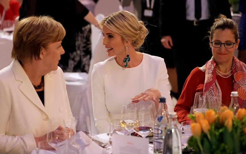 Ivanka Trump, daughter and adviser of U.S. President Donald Trump, center, and German Chancellor Angela Merkel, left, attend a dinner after they participated in the W20 Summit in Berlin - Credit: AP