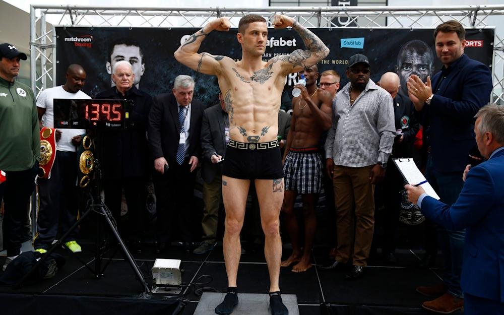 Ricky Burns at the weigh as Julius Indongo and promoter Eddie Hearn (R) look on - Credit: Reuters