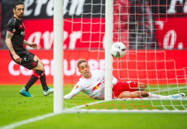 Leipzig's Yussuf Poulsen scores against Leverkusen in Leipzig, on April 8, 2017