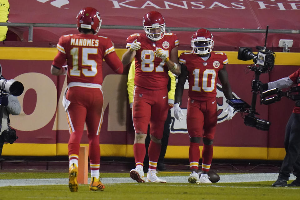 Kansas City Chiefs tight end Travis Kelce (87) celebrates his 20-yard touchdown reception with Patrick Mahomes (15) Tyreek Hill (10) in the second half of an NFL football game against the Denver Broncos in Kansas City, Mo., Sunday, Dec. 6, 2020. (AP Photo/Jeff Roberson)