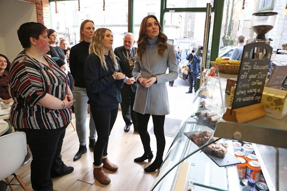 <p>After spending the morning in Northern Ireland, Kate made a quick outfit change before arriving in Aberdeen, Scotland. The Duchess swapped her outdoorsy olive coat for a sleek wool one, and traded in her farm-ready boots for a chic pair of ankle booties.</p>