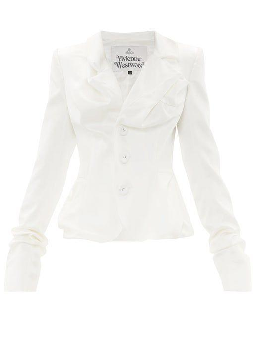 """<p><strong>Vivienne Westwood</strong></p><p>matchesfashion.com</p><p><strong>$879.00</strong></p><p><a href=""""https://go.redirectingat.com?id=74968X1596630&url=https%3A%2F%2Fwww.matchesfashion.com%2Fus%2Fproducts%2F1336645&sref=https%3A%2F%2Fwww.townandcountrymag.com%2Fstyle%2Ffashion-trends%2Fg36332074%2Fbest-bridal-wedding-jackets%2F"""" rel=""""nofollow noopener"""" target=""""_blank"""" data-ylk=""""slk:Shop Now"""" class=""""link rapid-noclick-resp"""">Shop Now</a></p><p>The artful draping and texture of the satin in this piece make it a statement on its own. But with the padded shoulders and tailoring in just the right places, it makes for a head-turning look with a simple bridal skirt. </p>"""