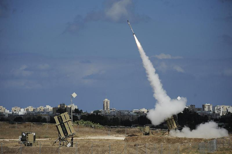 """A missile is launched by an """"Iron Dome"""" battery, a missile defence system designed to intercept and destroy incoming short-range rockets and artillery shells, in the southern Israeli city of Ashdod on July 18, 2014"""