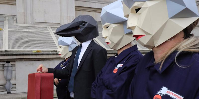 Protestors dressed as 'Maybots' demonstrate at the entrance of Downing Street as cabinet leave following a meeting ahead of the Chancellor's annual budget on November 22, 2017 in London, England. Later today Chancellor of the Exchequer Philip Hammond will deliver his 2017 budget to Parliament. The conservative government is continuing with its aim of reducing the deficit and balancing the books as the UK negotiates its departure from the European Union (Photo by )