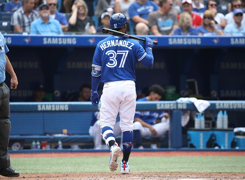 TORONTO, ON - AUGUST 22: Teoscar Hernandez #37 of the Toronto Blue Jays walks back to the dugout after striking out swinging to end the fifth inning during MLB game action against the Baltimore Orioles at Rogers Centre on August 22, 2018 in Toronto, Canada. (Photo by Tom Szczerbowski/Getty Images)