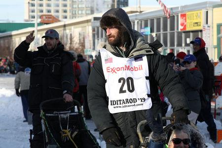 FILE PHOTO: Nicolas Petit (20) lines up at the ceremonial start of the Iditarod dog sled race in Anchorage, Alaska, U.S., March 2, 2019. REUTERS/Kerry Tasker