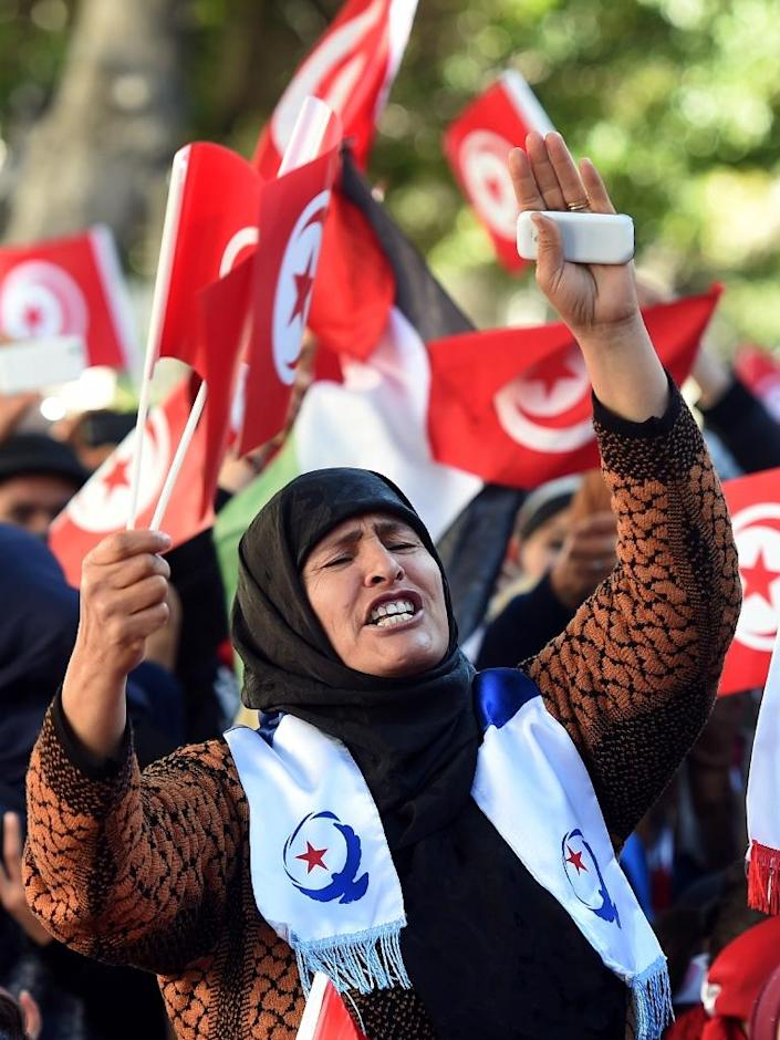 Fierce pride at the revolution in Tunisia is tempered by concerns over continued economic problems and a rise in jihadist violence (AFP Photo/Fethi Belaid)