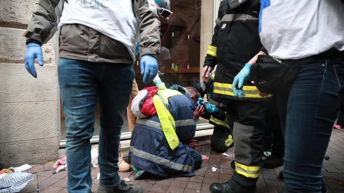 Olivier Beziade was treated by medics after being shot in the head in Bordeaux on Saturday (Picture: France Info)