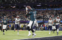 FILE - In this Feb. 4, 2018, file photo, Philadelphia Eagles' Nick Foles catches a touchdown pass during the first half of the NFL Super Bowl 52 football game against the New England Patriots, in Minneapolis. Rookie running back Corey Clement took the snap out of shotgun formation, rolled to his left and pitched the ball to third-string tight end Trey Burton, who caught it coming off the end, ran a few steps and floated a pass to backup quarterback Nick Foles in the end zone for a touchdown. Facing the mighty New England Patriots on the NFL's biggest stage, Philadelphia Eagles coach Doug Pederson's decision to try a trick play on a fourth down late in the first half of Super Bowl 52 will be remembered as one of the gutsiest calls in sports history. (AP Photo/Jeff Roberson, File)