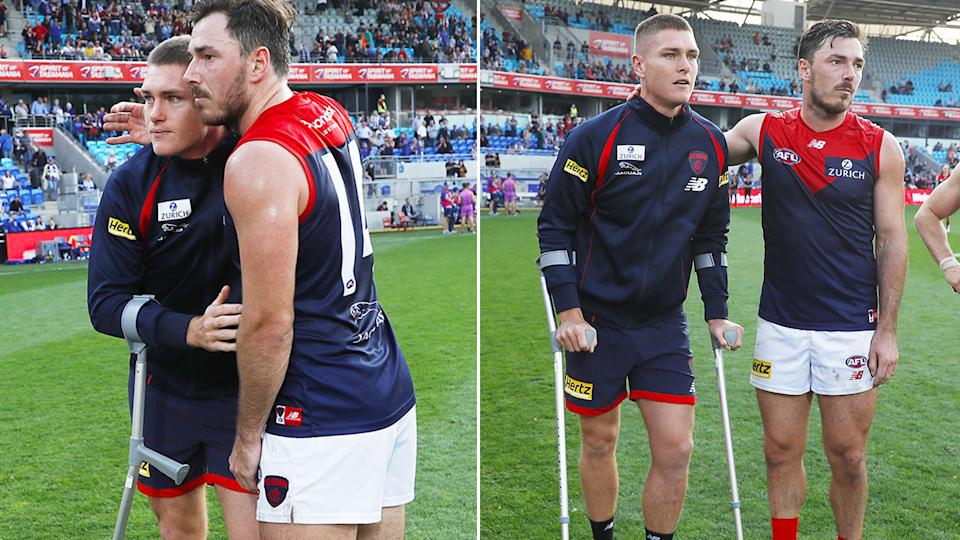 Pictured here, Melbourne's Adam Tomlinson is on crutches after tearing his ACL.