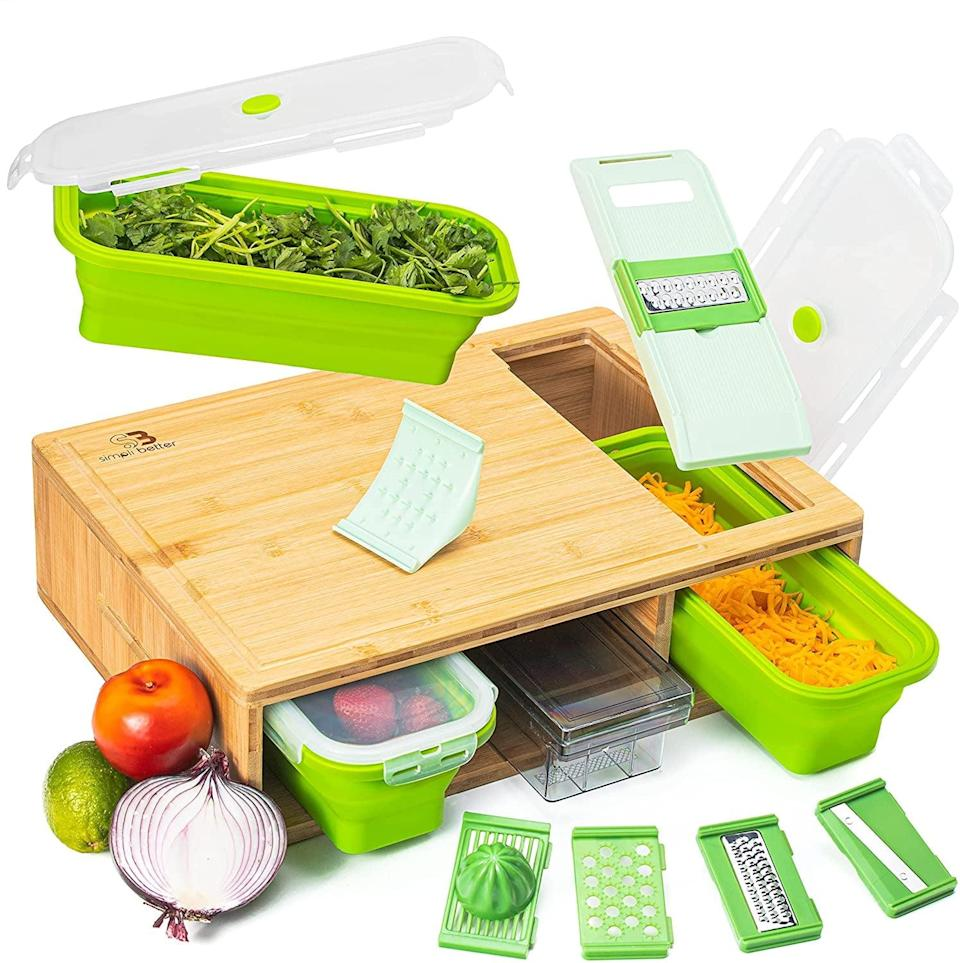<p>If they love to meal prep, we have a feeling they will love this <span>Bamboo Cutting Board With Trays</span> ($65). The handy compartments are so useful.</p>