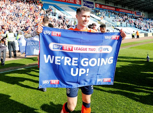 "Soccer Football - League Two - Carlisle United v Luton Town - Brunton Park, Carlisle, Britain - April 21, 2018 Luton Town's Dan Potts celebrates promotion after the game Action Images/John Clifton EDITORIAL USE ONLY. No use with unauthorized audio, video, data, fixture lists, club/league logos or ""live"" services. Online in-match use limited to 75 images, no video emulation. No use in betting, games or single club/league/player publications. Please contact your account representative for further details."