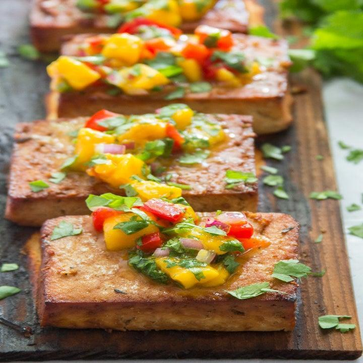 Blocks of tofu with colorful salsa on top