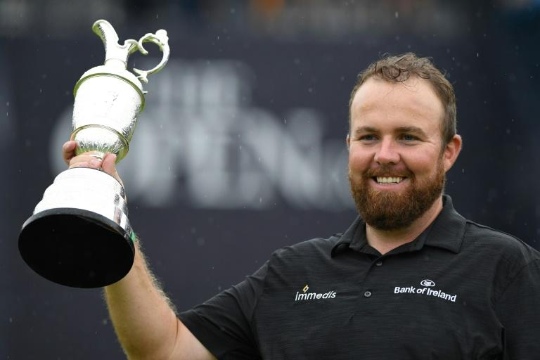 Ireland's Shane Lowry poses with the Claret Jug after winning the British Open on Sunday