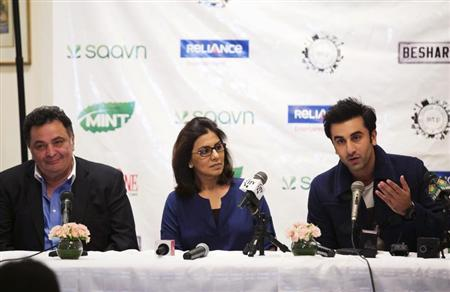 """Bollywood actors Ranbir Kapoor (R) and his parents Neetu and Rishi Kapoor (L) answer questions about what it is like to work together during a news conference discussing their new film """"Besharam"""" in New York, September 23, 2013. REUTERS/Lucas Jackson"""