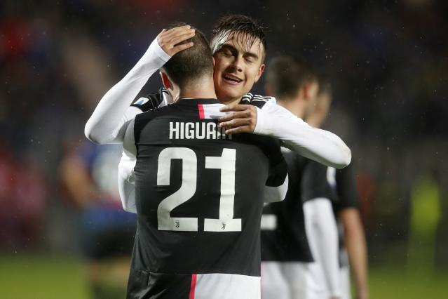Juventus' Paulo Dybala, face to camera celebrates with his teammate Gonzalo Higuain after scoring his side's third goal during the Serie A soccer match between Atalanta and Juventus at the Azzurri d'Italia Stadium in Bergamo, Italy, Italy, Saturday, Nov. 23, 2019. (AP Photo/Antonio Calanni)