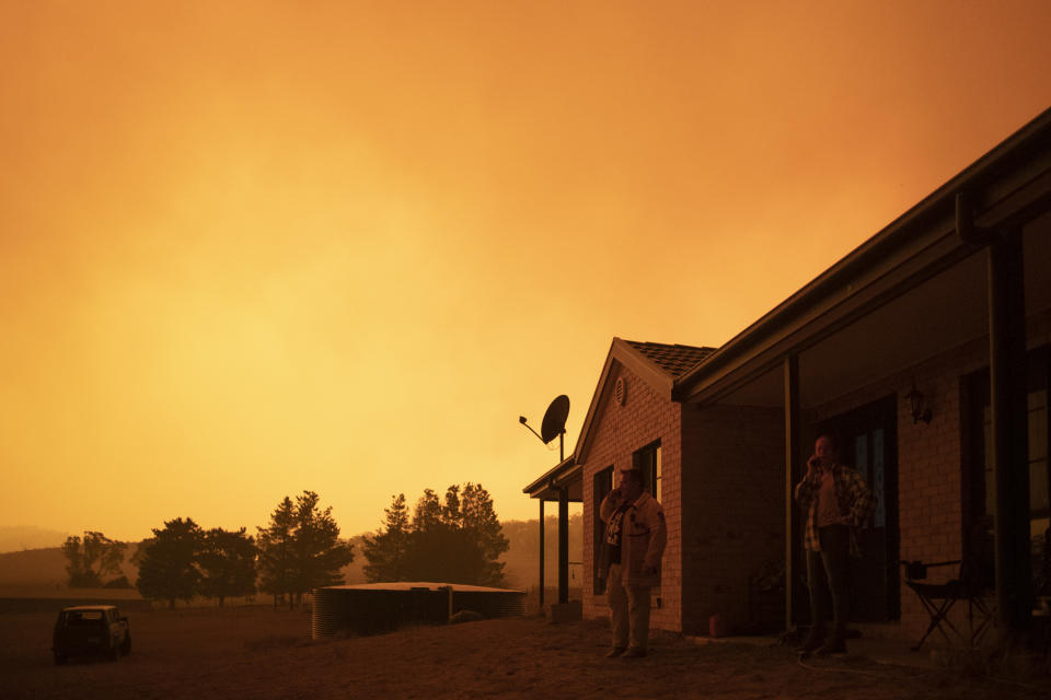 CANBERRA, AUSTRALIA - FEBRUARY 01: Lawrence and Claire Cowie are pictured as a fast moving fire moves towards their Bumbalong Road, Bredbo North property on February 01, 2020 near Canberra, Australia. ACT Chief Minister Andrew Barr declared a State of Emergency on Friday, as the Orroral Valley bushfire continues to burn out of control. Hot and windy weather conditions forecast for the weekend are expected to increase the bushfire threat to homes in the Canberra region. It is the worst bushfire threat for the area since 2003, when four people died and 470 homes were destroyed or damaged. (Photo by Brook Mitchell/Getty Images)