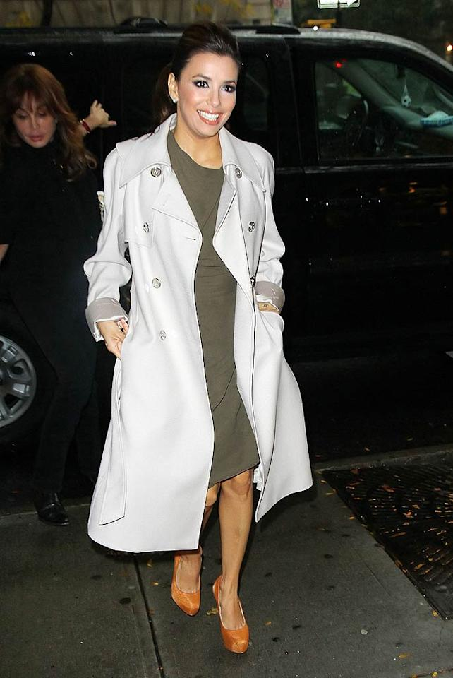 Eva Longoria stayed dry on a dreary New York day thanks to her double-breasted coat. (10/27/2011)