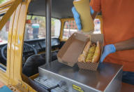 Emad Abdeljawwad sells hot dogs and beverages out of a converted van in the West Bank city of Ramallah, Wednesday, Sept. 23, 2020. The coronavirus crisis has hit West Bank restaurants hard. But one part of the dining sector is bucking the trend: food trucks. (AP Photo/Nasser Nasser)