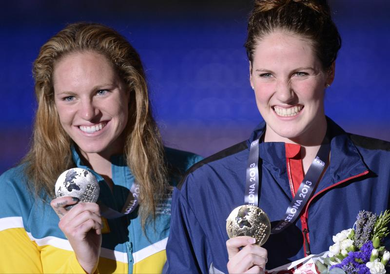 Missy Franklin of the United States, right, smiles as she holds her gold medal with Australia's Emily Seebohm, silver, after the presentation ceremony for the Women's 100m backstroke final at the FINA Swimming World Championships in Barcelona, Spain, Tuesday, July 30, 2013. (AP Photo/Manu Fernandez)