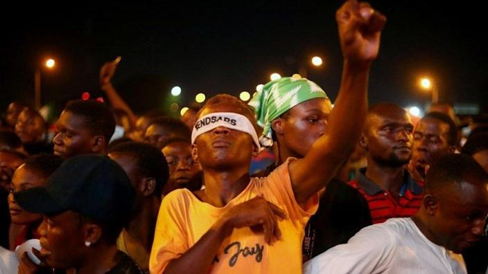 "A demonstrator wearing a blindfold with an inscription ""End Sars"", gestures during protest against alleged police brutality in Lagos, Nigeria October 17, 2020"