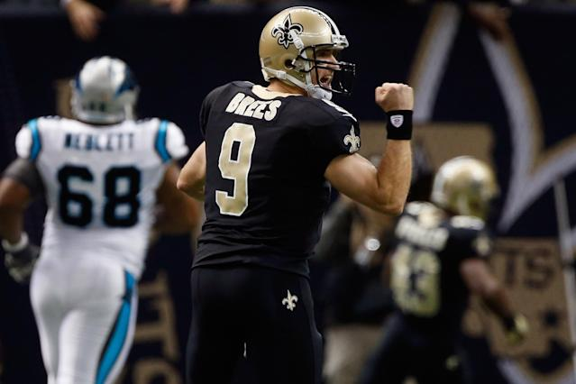 NEW ORLEANS, LA - DECEMBER 30: Drew Brees #9 of the New Orleans Saints reacts after throwing a touchdown pass to Darren Sproles #43 of the New Orleans Saints during the game against the Carolina Panthers at the Mercedes-Benz Superdome on December 30, 2012 in New Orleans, Louisiana. (Photo by Chris Graythen/Getty Images)