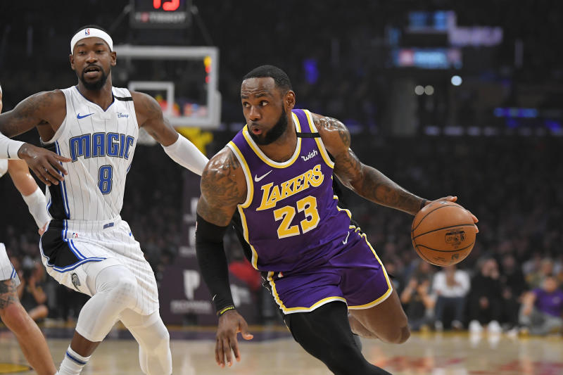 Los Angeles Lakers forward LeBron James, right, drives toward the basket as Orlando Magic guard Terrence Ross defends during the first half of an NBA basketball game Wednesday, Jan. 15, 2020, in Los Angeles. (AP Photo/Mark J. Terrill)