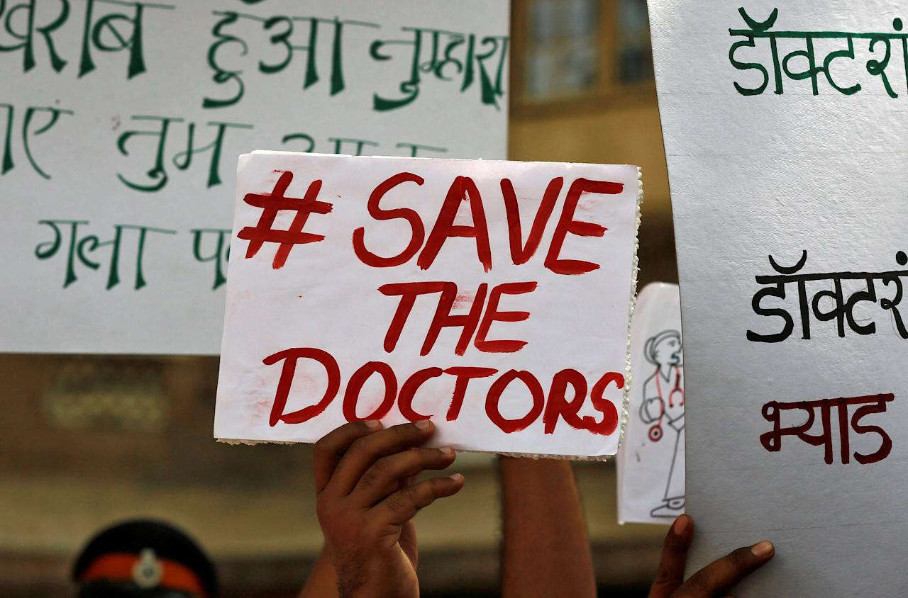 Doctors carry placards outside the King Edward Memorial (KEM) Hospital during a protest demanding security after the recent assaults on doctors by the patients' relatives, in Mumbai, India, March 23, 2017. REUTERS/Shailesh Andrade