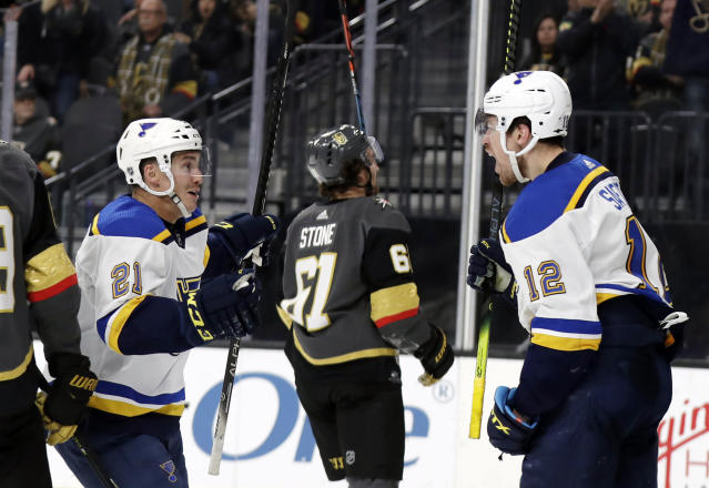 St. Louis Blues forward Tyler Bozak (21) and forward Zach Sanford (12) celebrate a Blues goal against the Vegas Golden Knights during the third period of an NHL hockey game Thursday, Feb. 13, 2020, in Las Vegas. Both player scored in the period. The Golden Knights won 6-5 in overtime. (AP Photo/Isaac Brekken)