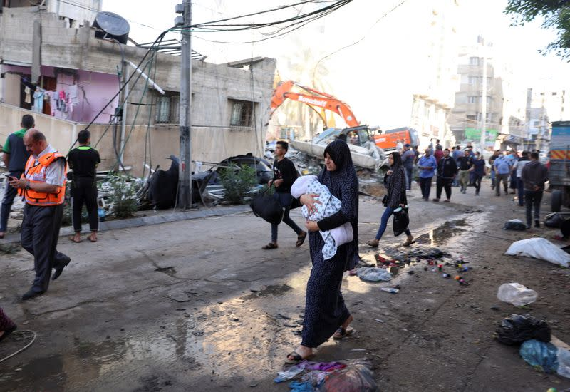 Rescue search for victims at the site of Israeli air strikes, in Gaza City