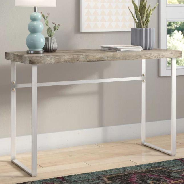 """Get it at <a href=""""https://www.allmodern.com/Mercury-Row-Ponticus-Console-Table-MCRR5502.html"""" target=""""_blank"""">All Modern, $130</a>."""