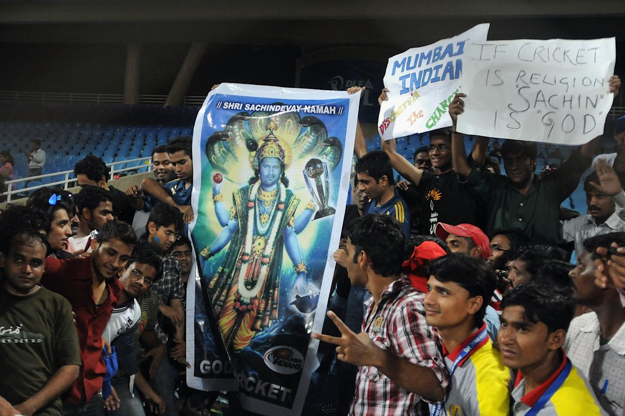 MUMBAI, INDIA - MARCH 28: Fans display a poster with Sachin Tendulkar as god of cricket  during the 2010 DLF Indian Premier League T20 group stage match between Deccan Chargers and Mumbai Indians played at DY Patil Stadiu on March 28, 2010 in Mumbai, India.  (Photo by Pal Pillai-IPL 2010/IPL via Getty Images)