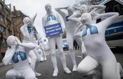 """Greenpeace activists wearing white morphsuits with lungs painted on them demonstrated for clean air in Stuttgart in February. The sign read: """"We have the right to clean air"""""""