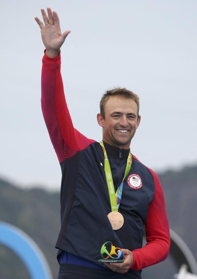 2016 Rio Olympics - Sailing - Victory Ceremony - Men's One Person Dinghy (Heavyweight) - Finn - Marina de Gloria - Rio de Janeiro, Brazil - 16/08/2016. Caleb Paine (USA) of USA poses with his bronze medal. REUTERS/Benoit Tessier FOR EDITORIAL USE ONLY. NOT FOR SALE FOR MARKETING OR ADVERTISING CAMPAIGNS.