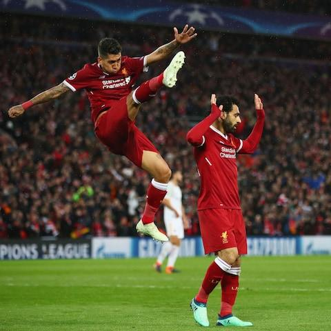 Roberto Firmino, left, and Mohamed Salah scored two each as Liverpool raced to a five-goal lead - Credit: Clive Brunskill/Getty Images