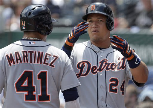 Detroit Tigers' Miguel Cabrera (24) celebrates with teammate Victor Martinez (41) after hitting a solo home run during the first inning of a baseball game against the Kansas City Royals, Sunday, July 21, 2013, in Kansas City, Mo. (AP Photo/Charlie Riedel)