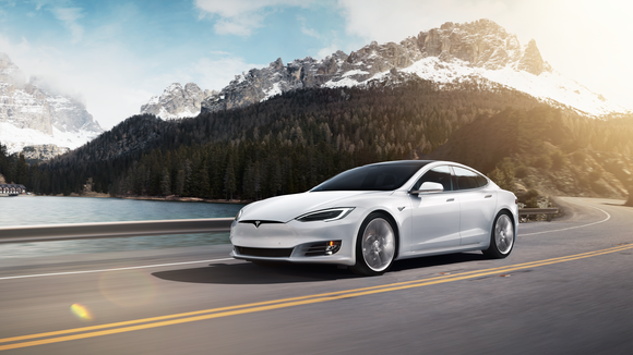 A white Model S driving in the mountains