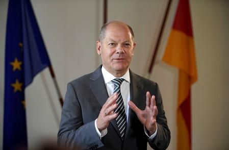 FILE PHOTO: German Finance Minister Olaf Scholz poses for a portrait during an interview with Reuters in his ministry in Berlin