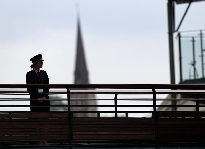 A security guard watches over some of the courts at the Wimbledon Tennis Championships, in London