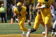 Baylor quarterback Gerry Bohanon (11) rushes the ball against Baylor during the first half of an NCAA college football game, Saturday, Sept. 25, 2021, in Waco, Texas. (AP Photo/Jim Cowsert)